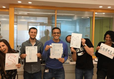 CoderZ team with STEM signs