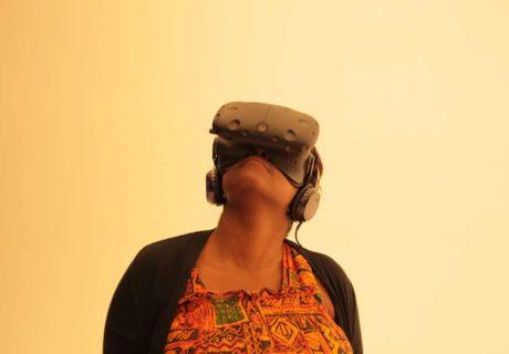 CoderZ Virtual Robotics How we teach Woman with virtual reality headset