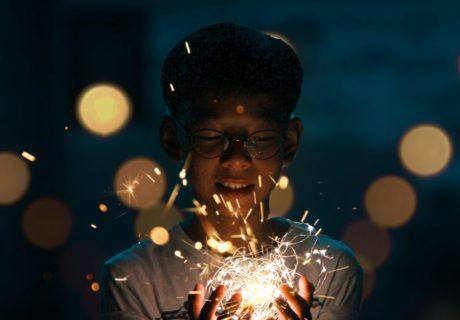 Asian teen holds sparkler Imagination coderZ NASA resources for Educators in hand stem education