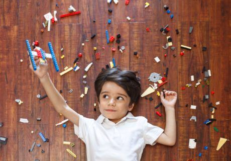 Young Boy Surrounded by Legos