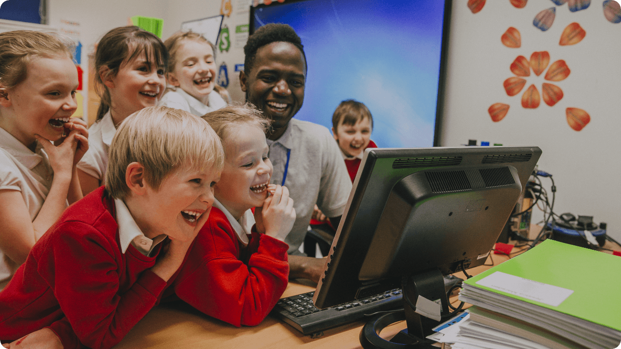 Computer science teacher in a classroom with elementary school children